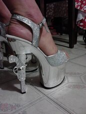 shoes,stripper heels,gun heels,silver heels,silver shoes