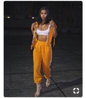 jacket,yellow,yellow coat,yellow pants,baggy pants,bra,crop tops,cropped,orange,orange tank top,streetstyle,streetwear,hype,hypebeast,supreme,bape,off-white