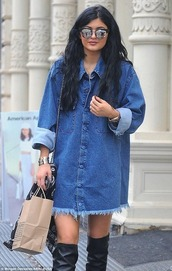 denim shirt,denim,kylie jenner,thigh highs,jeans,sunglasses,top,pocket dress,denim dress,button up dress,frayed denim,jacket,jean jackets,oversized,fall outfits,winter outfits,blouse,denim blouse,boots,black boots,shirt,knee high boots,denim jacket