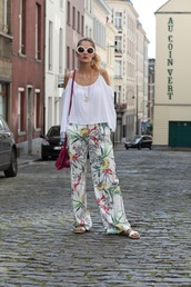 from brussels with love,blogger,jewels,blouse,shoes,bag,sunglasses,wide-leg pants,floral pants,white top,off the shoulder,round sunglasses,flats
