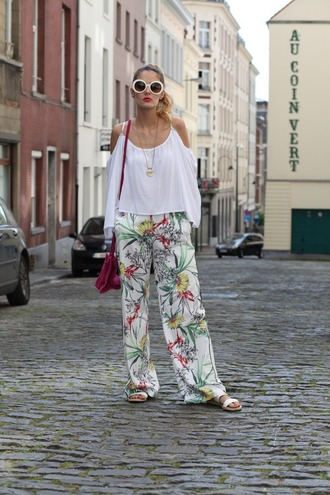 from brussels with love blogger jewels blouse shoes bag sunglasses wide-leg pants floral pants white top off the shoulder round sunglasses flats