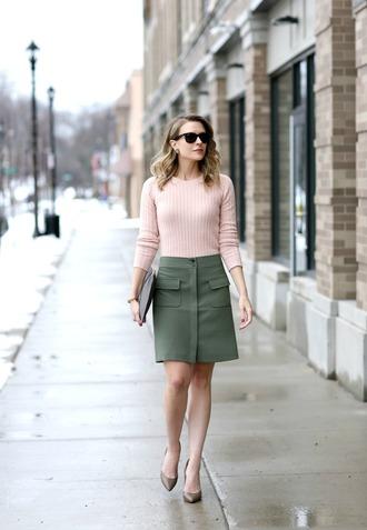 pennypincherfashion blogger sweater skirt shoes bag green  skirt pink sweater clutch high heel pumps
