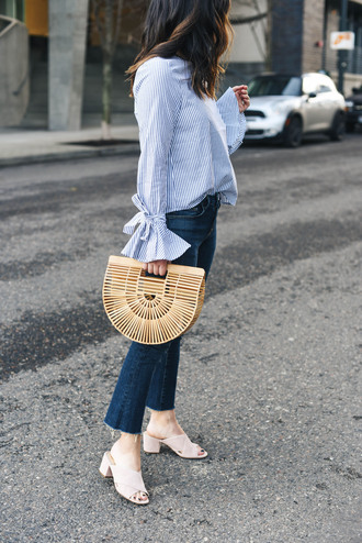 crystalin marie blogger top jeans bag sunglasses bell sleeves blue shirt mules