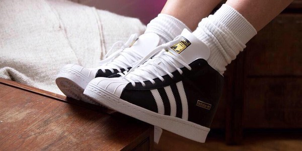 black and white superstar adidas high top