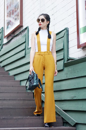 olivia lazuardy,blogger,sunglasses,jewels,jumpsuit,yellow,white top,round sunglasses,mini bag,black boots