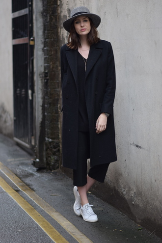 shot from the street blogger hat black coat cropped pants