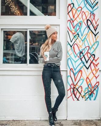top tumblr stripes striped top grey beanie beanie pom pom beanie denim jeans black jeans side stripe pants boots black boots ankle boots