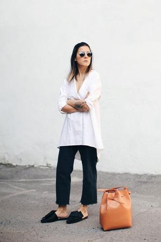 elif filyos blogger shirt jeans asymmetric shirt white shirt long shirt black jeans frayed jeans sunglasses bucket bag brown bag slide shoes black slides asymmetrical top