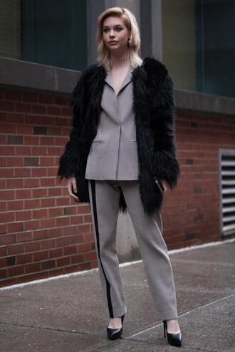 pants nyfw 2017 fashion week 2017 fashion week streetstyle grey pants side stripe pants matching set two piece pantsuits power suit coat black coat fur coat big fur coat faux fur coat blazer grey blazer pumps pointed toe pumps high heel pumps black heels