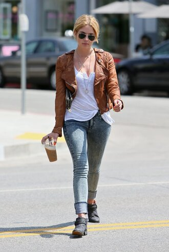 jeans cuffed jeans ashley benson celebrity style celebrity actress blue jeans acid wash jeans top white top jacket leather jacket brown leather jacket brown jacket boots black boots flat boots sunglasses aviator sunglasses
