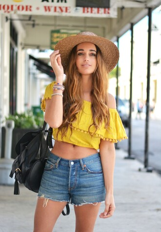 stella wants to die blogger hat spring outfits summer outfits straw hat crop tops off the shoulder yellow top denim shorts black backpack
