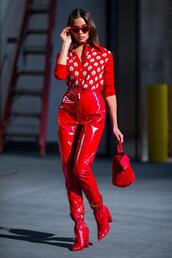 pants,red,red pants,olivia culpo,streetstyle,fall outfits,boots,sunglasses,cardigan