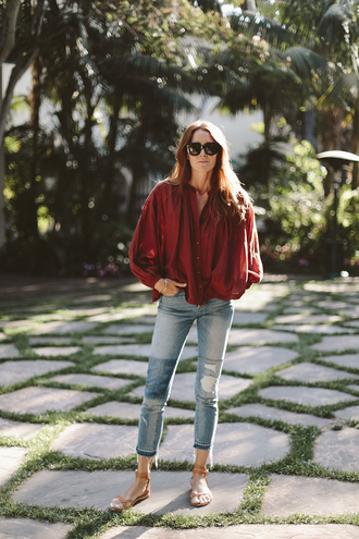 blogger blouse jeans jewels shoes red top long sleeves button up burgundy skinny jeans flats lace up flats denim flat sandals blue jeans ripped jeans black sunglasses sunglasses spring outfits