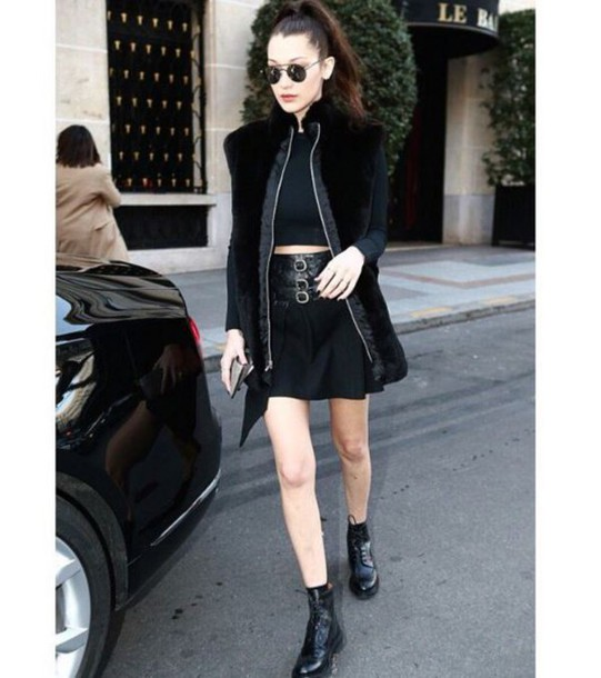 skirt top jacket coat fall outfits bella hadid all black everything ankle boots sunglasses crop tops celebrity model off-duty black crop top faux fur vest vest black vest black skirt mini skirt boots lace up boots black boots