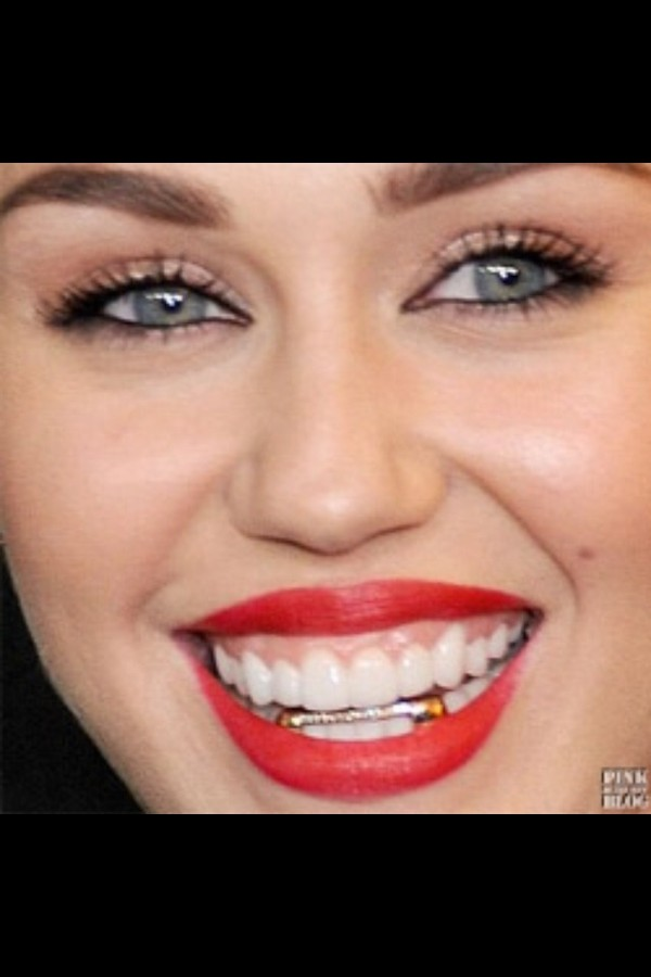 jewels miley cyrus gold grillz