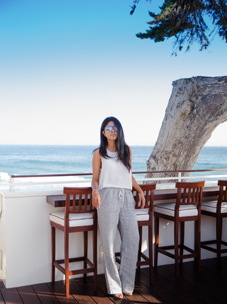 walk in wonderland blogger top pants shoes sunglasses
