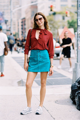 vanessa jackman blogger teal suede skirt lace up skirt blue skirt mini skirt a line skirt shirt brown shirt sunglasses summer outfits sneakers grey sneakers streetstyle