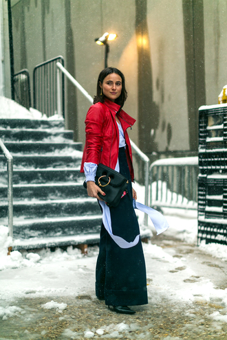 jacket nyfw 2017 fashion week 2017 fashion week streetstyle red jacket leather jacket pants black pants wide-leg pants shirt blue shirt bag black bag