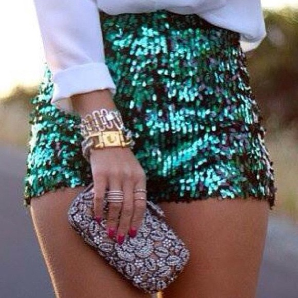 green shorts shorts green clutch bag