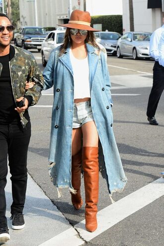 coat denim denim jacket boots hat chrissy teigen model off-duty shorts denim shorts streetstyle celebrity shoes