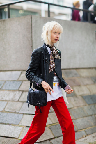 pants fashion week street style fashion week 2016 fashion week london fashion week 2016 red pants t-shirt white t-shirt graphic tee black leather jacket leather jacket black jacket jacket bag black bag streetstyle fall outfits