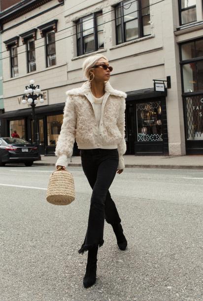 the haute pursuit blogger jacket sunglasses bag shoes basket bag winter outfits boots tumblr handbag white jacket fuzzy jacket denim jeans black jeans frayed denim cropped jeans black boots