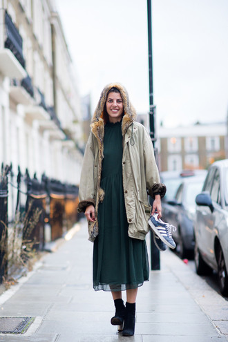 man repeller blogger dress shoes coat green dress midi dress fall outfits ankle boots hooded winter coat