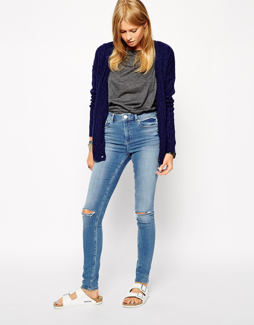 ASOS Ridley Jeans in Gothenburg Mid Wash Blue with Ripped Knees at asos.com