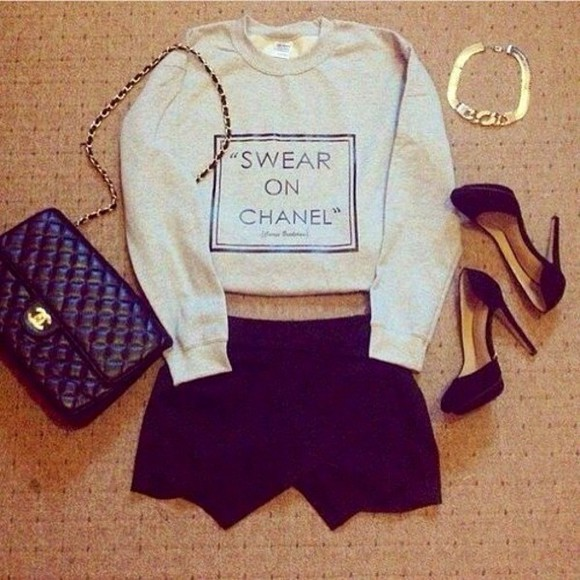 grey sweater chanel skirt swear on beige cropped bag high heels black high heels shorts chanel bag gold bracelet shirt text text sweater swear on chanel