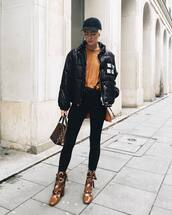 jacket,black cap,tumblr,black jacket,puffer jacket,denim,jeans,black jeans,boots,brown boots,top,mustard,cap,fall outfits,down jacket,fall jacket,puff jacket,lace-up shoes,louis vuitton bag,black baseball hat