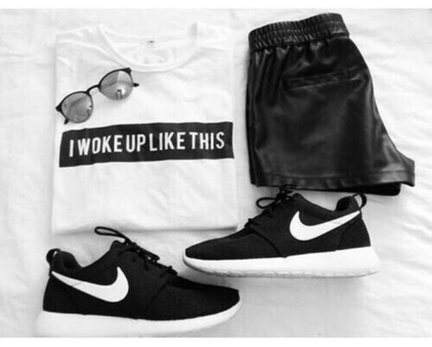 shoes shirt black and white shorts sunglasses t-shirt i woke up like this black black shorts leather leather shorts leather black leather black shoes white sneakers nike nike sneakers