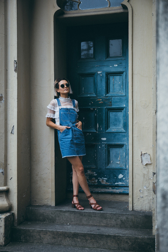 le fashion image blogger sunglasses dress shoes white top denim dress overalls mini dress ruffle flats lace up flats rayban frayed denim blue dress lace top ruffled top summer outfits sandals mid heel sandals pocket dress