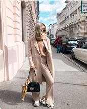 coat,wool coat,double breasted,wide-leg pants,turtleneck sweater,handbag,sneakers,round sunglasses
