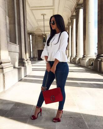 blouse white blouse jeans blue jeans bag red bag shoes red shoes