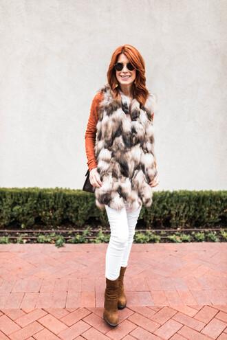 themiddlepage blogger t-shirt jacket jeans shoes bag jewels fur vest winter outfits white pants ankle boots
