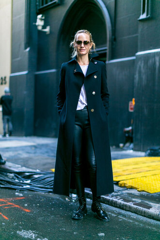 coat nyfw 2017 fashion week 2017 fashion week streetstyle long coat black long coat black coat t-shirt white t-shirt leggings black leggings leather leggings boots black boots sunglasses