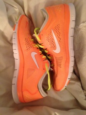 shoes,nike,nike running shoes,nike sneakers,nike free run,neon orange,orange and neon pink nikes,trainers,running,sportswear,athletic,bright sneakers