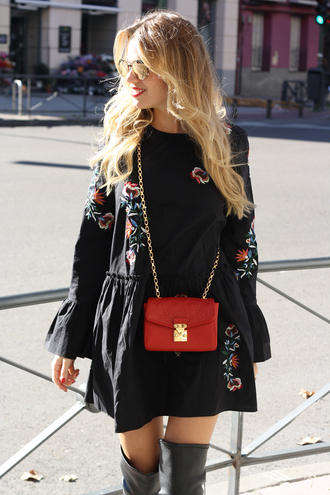 dress tumblr embroidered dress embroidered mini dress black dress long sleeves long sleeve dress bell sleeves bag red bag chain bag blonde hair boots grey boots over the knee boots bell sleeve dress
