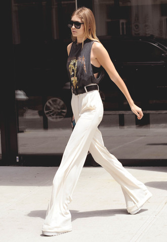 white pants high waisted pants gigi hadid celebrity style celebrity model off-duty top black top sunglasses black sunglasses