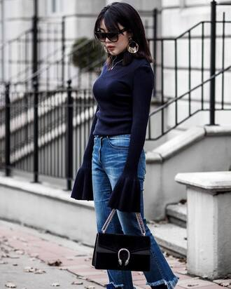 sweater tumblr bell sleeve sweater bell sleeves blue sweater bag black bag gucci gucci bag earrings silver earrings hoop earrings denim jeans blue jeans flare jeans sunglasses work outfits