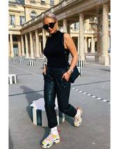 top,turtleneck,sleeveless top,leather pants,black pants,sneakers,platform sneakers,shoulder bag,sunglasses,earrings