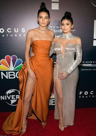 dress silver gown prom dress kardashians kylie jenner kendall and kylie jenner kendall jenner slit dress orange dress orange pumps red carpet dress strapless plunge dress golden globes 2017