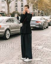 coat,wool coat,black coat,wide-leg pants,white sneakers,crossbody bag