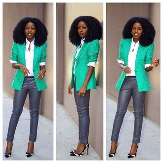 jacket sea green heels big hair curly hair