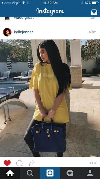 t-shirt yellow kylie jenner kylie jenner shirt supreme supreme t-shirt supreme clothing yellow t-shirt top instagram purse bag shirt dope bogo box logo love hip hop women streetwear streetwear blue bag tote bag