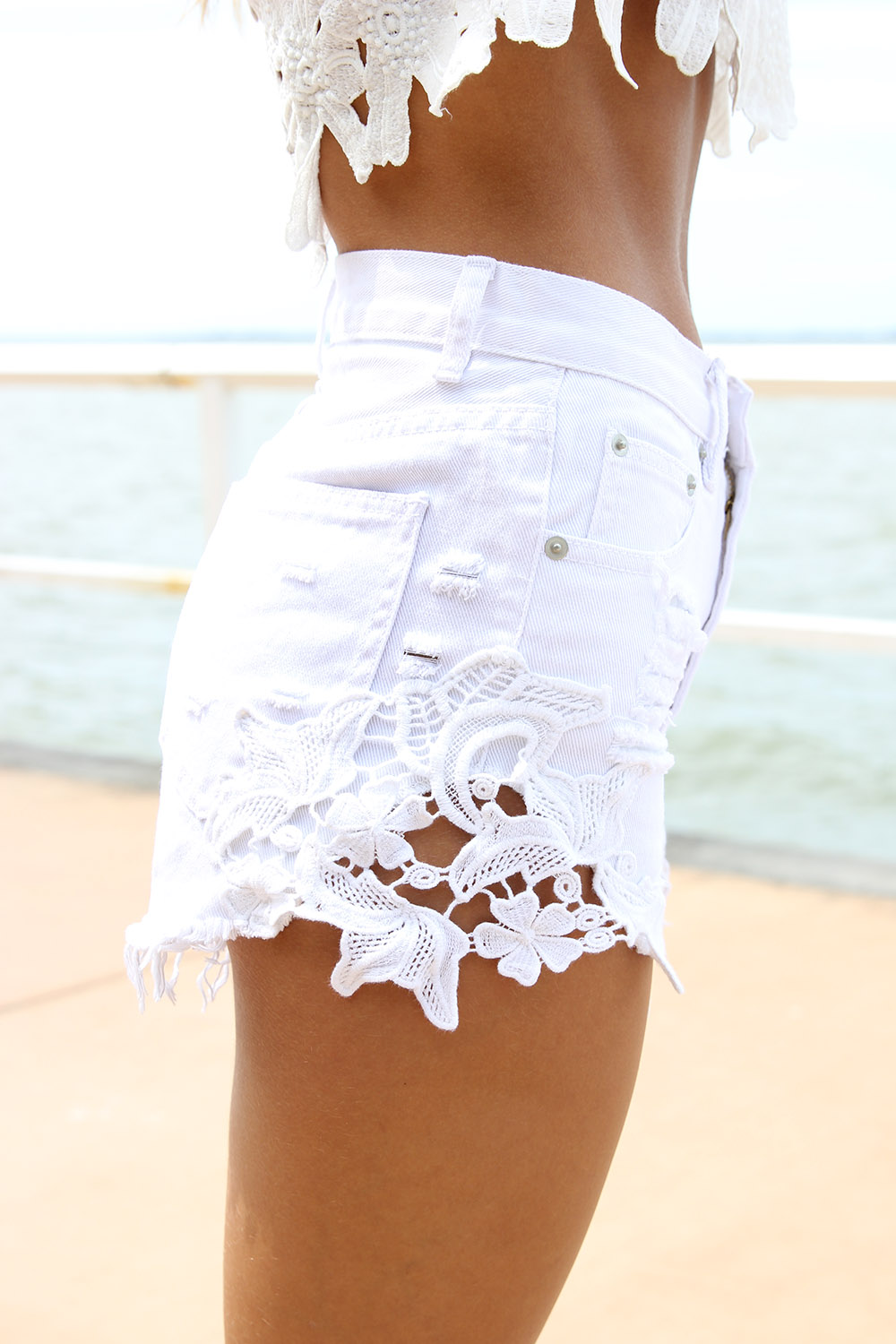 Denim short in white Item A size & fit. City fit—our lowest rise. Sits just above hip. 4