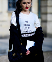 t-shirt,tumblr,fashion week 2017,streetstyle,white t-shirt,quote on it,equality,feminist,tights,net tights,fishnet tights,coat,black coat,bag,black bag,red lipstick,lipstick,hoop earrings,earrings,jewels,kristina bazan,kayture,top blogger lifestyle,feminist tshirt