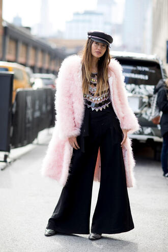 coat nyfw 2017 fashion week 2017 fashion week streetstyle pink coat pants black pants wide-leg pants top see through see through top hat fisherman cap