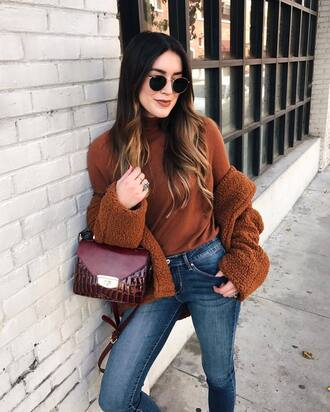 jacket tumblr fuzzy jacket brown fluffy brown jacket sweater turtleneck sunglasses round sunglasses jeans denim blue jeans bag brown bag fall outfits rust fuzzy coat fall colors mini bag crocodile