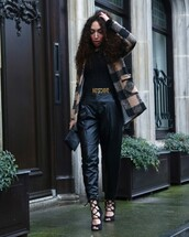 from hats to heels,blogger,belt,curly hair,leather pants,strappy sandals,black pants,moschino,flannel,coat,pants,top,shoes,bag